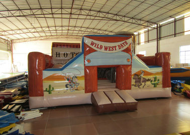 China Wild inflatable western themed bouncer house PVC material inflatable farm house fun amusement park distributor